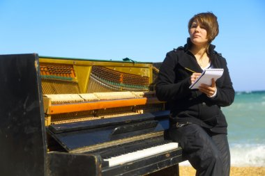 pensive woman at the old piano
