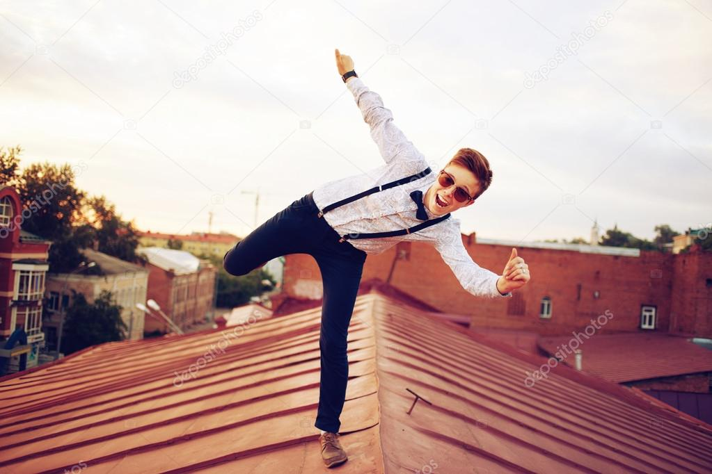 Young happy hipster girl jump on roof