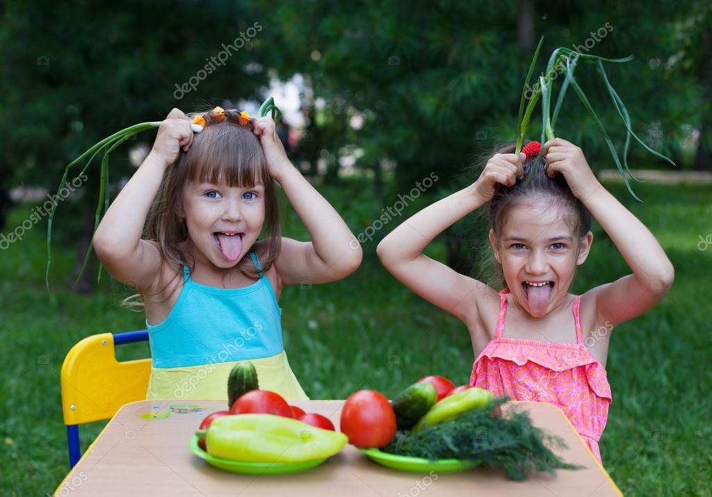 Happy children with vegetables