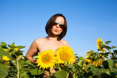 nude sexy girl with sunflowers