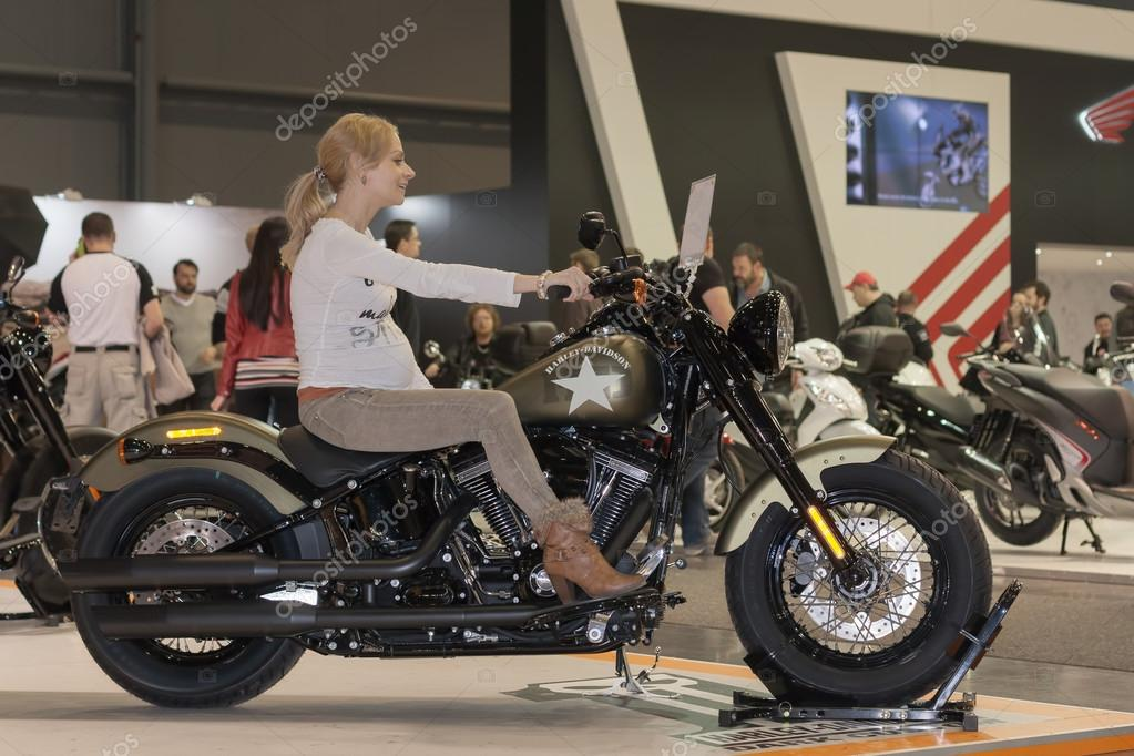 motorcycle photography d  Pregnant woman as visitor trying to sit on motorcycles Harley D ...