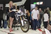 Beautiful hostesses present motorcycle Honda CRF1000L Africa Twi