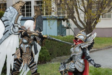 Two cosplayers dressed as the characters Uriel and Haven  Paladi