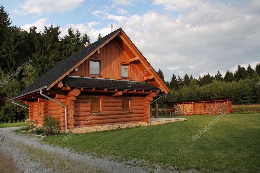 Wood log cabin near forest