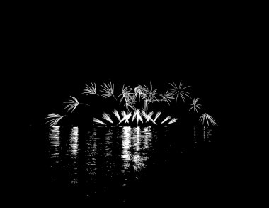 Fireworks with reflection on lake