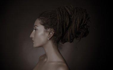 Woman with a big dreadlocks bun hairstyle stock vector
