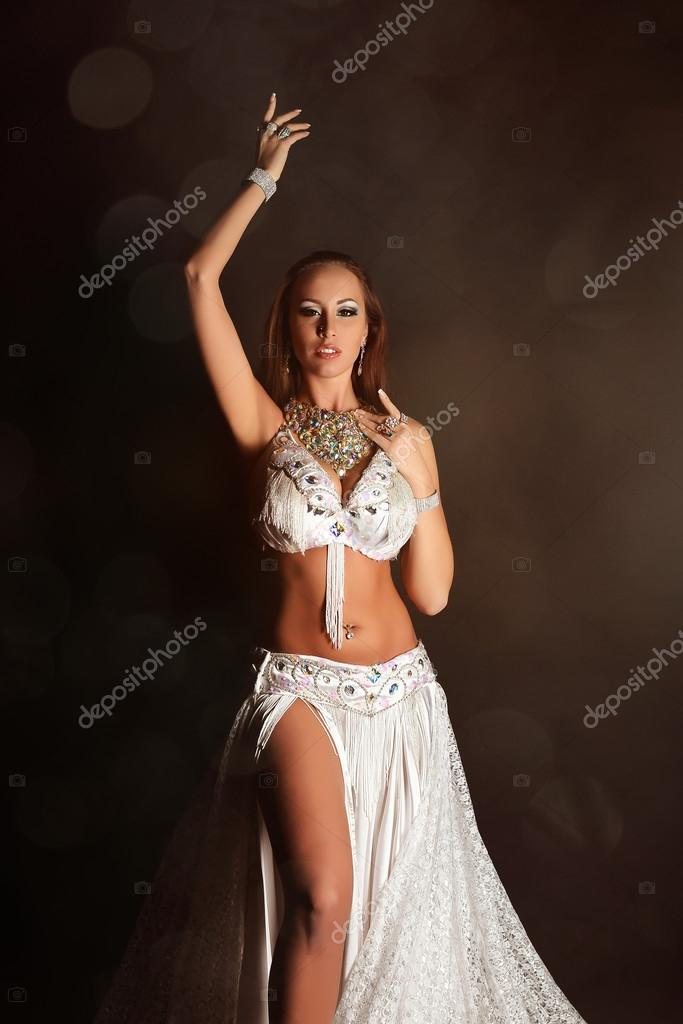 d83daf9e74b88 Portrait of beautiful woman in white stage arabic belly dance costume —  Photo by ...