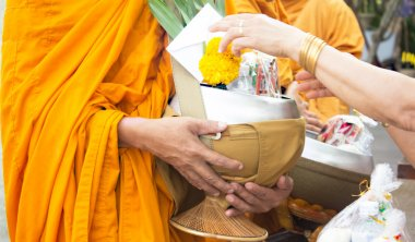 Giving alms to monks receive alms