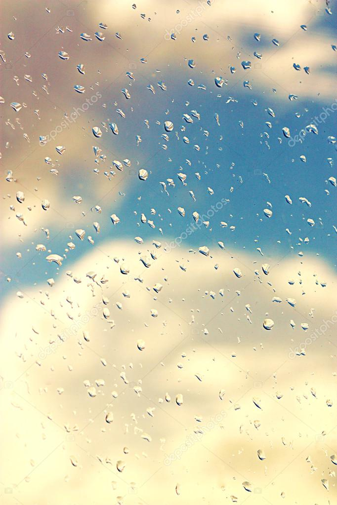 Raindrops on glass with clouds