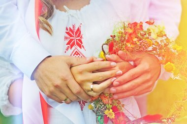 Happy couple holding each other's hands. Russian wedding, wedding rings
