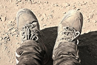 Old shoes, holey dusty sneakers, worn shoes, hiking.