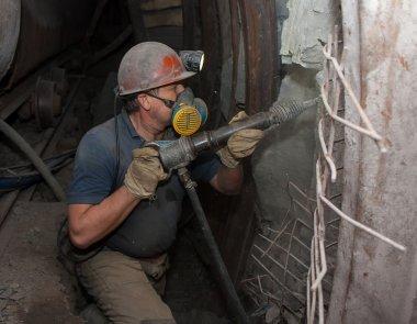 Donetsk, Ukraine - March, 14, 2014: Miner working underground in