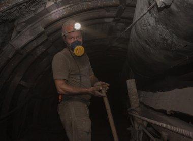 Donetsk, Ukraine - March, 14, 2014: The miner working undergroun
