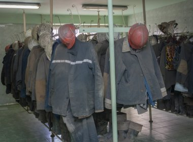 Overalls miners working in the locker room