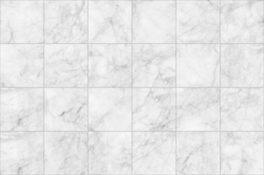 White marble tiles seamless flooring texture background.