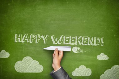 Happy weekend concept on green blackboard