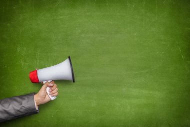 Green blank blackboard with hand holding megaphone