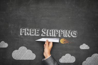 Free shipping concept on blackboard