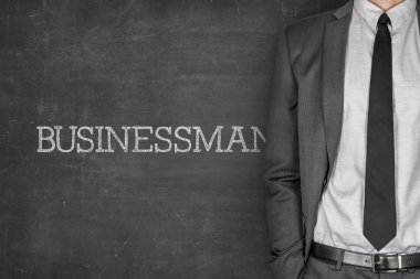Businessman on blackboard