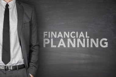 Financial planning text on black blackboard