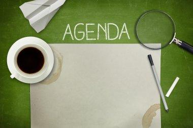 Agenda concept on blackboard with empty paper sheet