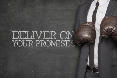 Deliver on your promises on blackboard with businessman