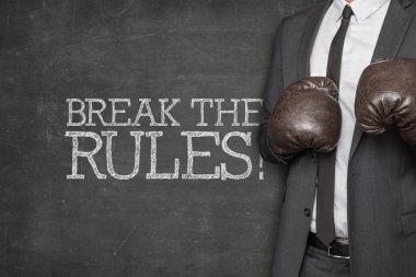 Break the rules on blackboard with businessman