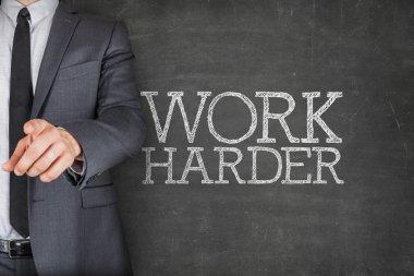 Work harder on blackboard with businessman