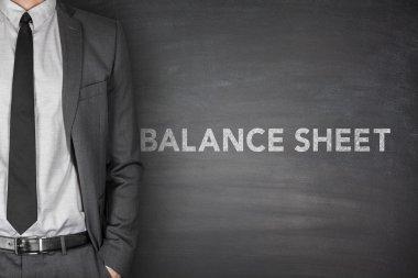 Balance sheet text on blackboard