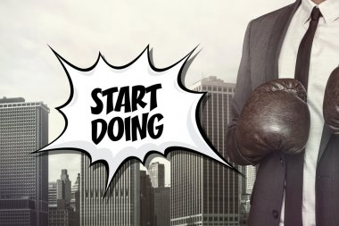 Start doing text with businessman wearing boxing gloves