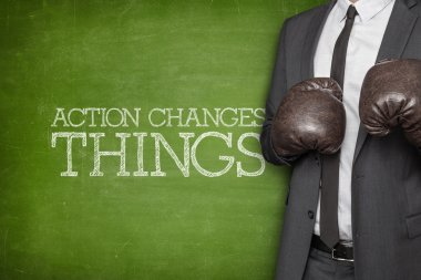 Action changes things on blackboard with businessman on side