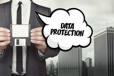 Data protection text on speech bubble with businessman holding diskette