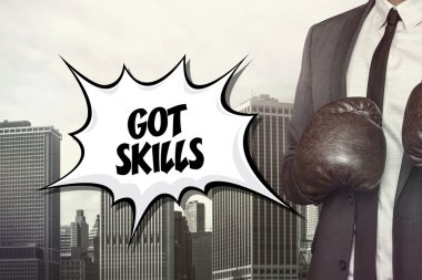Got skills text with businessman wearing boxing gloves