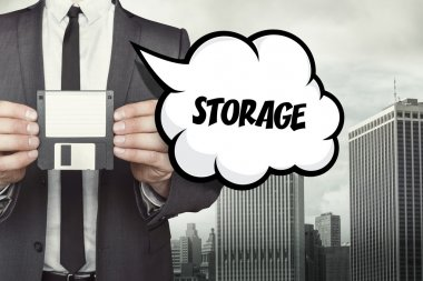 Storage text on speech bubble with businessman holding diskette