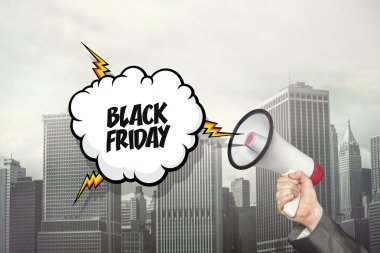 Black friday text on speech bubble and businessman hand holding megaphone