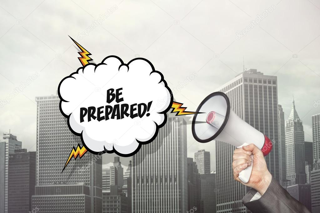 Be prepared text on speech bubble and businessman hand holding megaphone