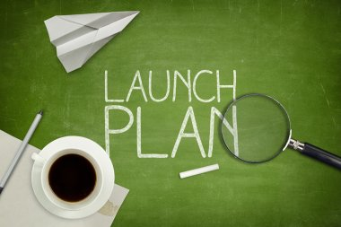 Launch plan concept on black blackboard