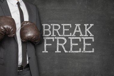 Break free on blackboard with businessman on side