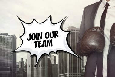 Join our team text with businessman wearing boxing gloves