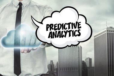 Predictive analytics text on cloud computing theme with businessman