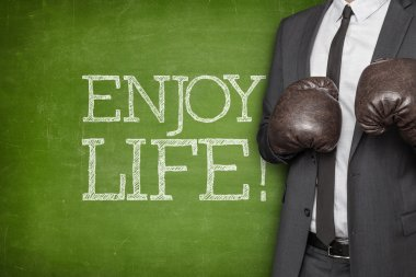 Enjoy life on blackboard with businessman on side