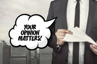 Your opinion matters text on speech bubble with businessman holding paper plane in hand