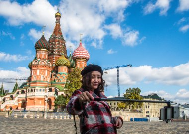Moscow, Russia, 01.10.2014 - Chinese tourist takes pictures on your smartphone with selfie-stick on the Red Square