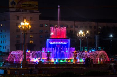 Illuminated fountains on the main square of Khabarovsk, Russia -