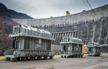 Power generators on a background of the dam of Sayano-Shushenska