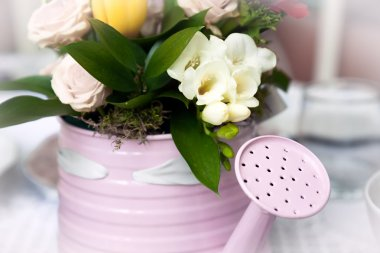 Romantic bouquet in flower pot in form of watering can