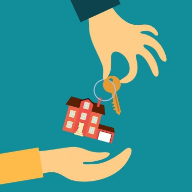 hand real estate agent holding transmits a key with a tag in the form of a home buyer