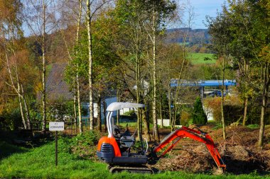 Excavator on a building plot