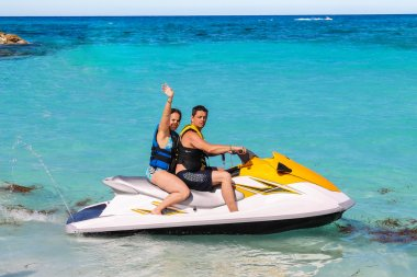 Man and woman on a jet ski