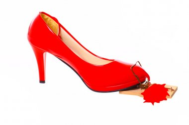 Bleeding Red High Heel in a mousetrap.